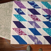 A quilt block on an ironing board.