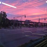 A pink sunset over a highway.